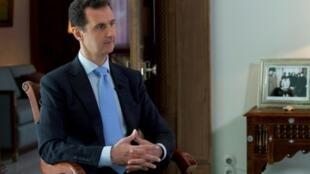 صورة نشرتها وكالة سانا للرئيس السوري خلال مقابلة تلفزيونية في دمشق في 29 نوفمبر 2015