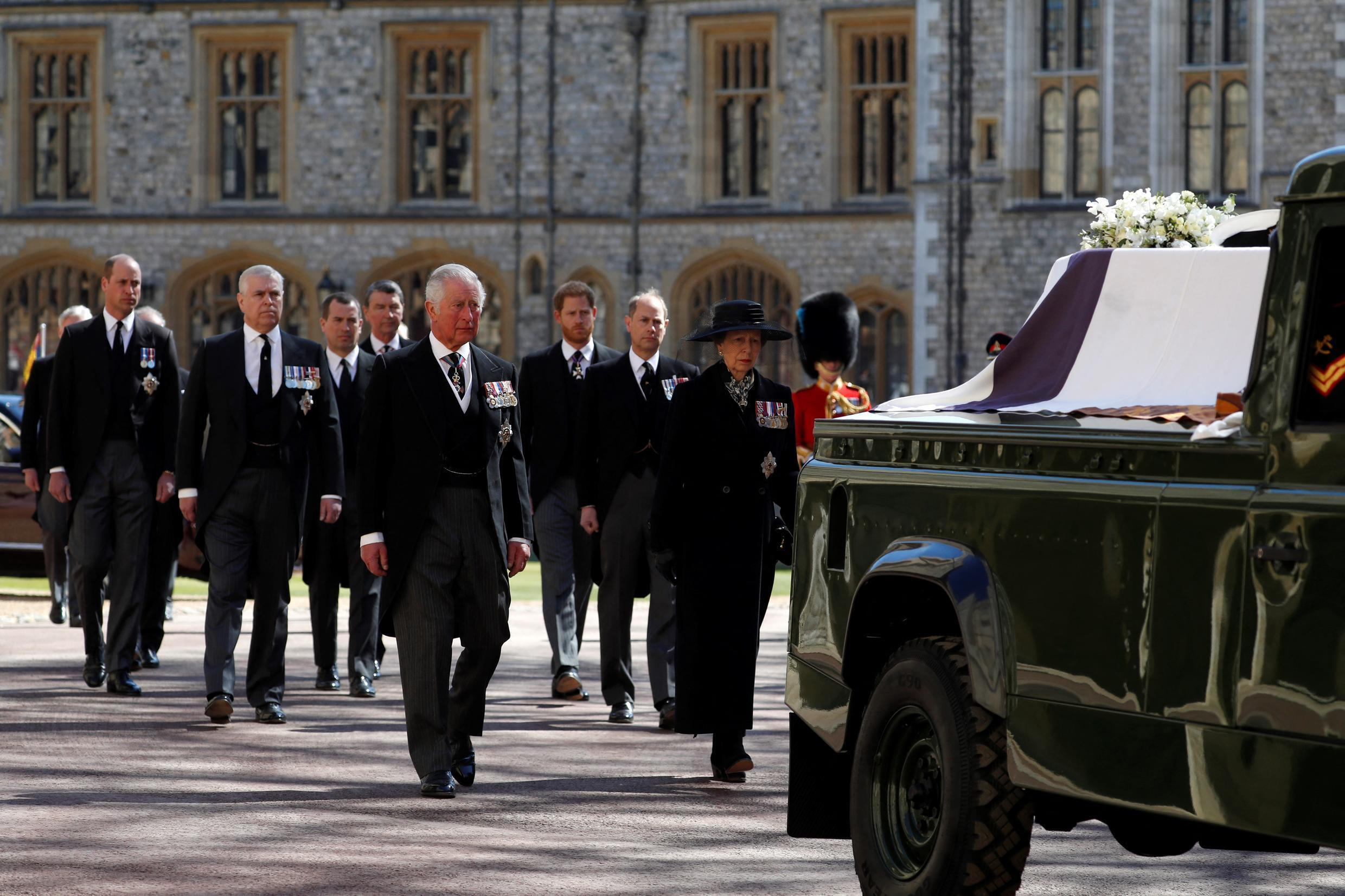 Prince Charles of England, Prince of Wales and Princess Anne of England, Princess Royal, lead the ceremonial funeral procession of Prince Philip of England, Duke of Edinburgh towards St George's Chapel at Windsor Castle in Windsor, west of London, April 17, 2021.