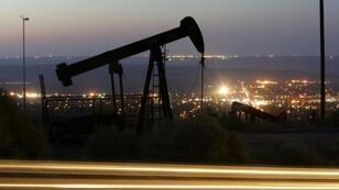 A jump in US stockpiles sent oil prices tumbling Wednesday, fuelling a sell-off in Asian energy shares