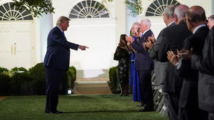 US President Donald Trump arrives to listen to first lady Melania Trump deliver her live address to the largely virtual 2020 Republican National Convention from the Rose Garden of the White House in Washington, D.C, USA, August 25, 2020.