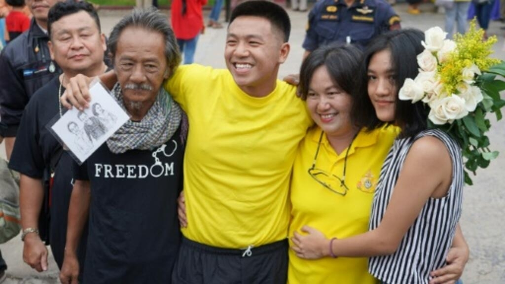 Thai activist jailed for insulting monarchy freed in royal