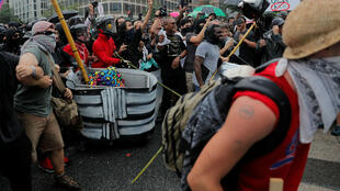 Manifestantes en el primer aniversario de las protestas de Charlottesville, en Washington, DC., el 12 de agosto de 2018.
