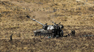 An Israeli army self-propelled artillery piece takes part in a military drill in the Israeli-annexed Golan Heights on June 24, 2020