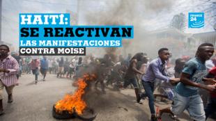 Vista de los disturbios registrados este domingo durante una manifestación en Puerto Príncipe (Haití). Varias personas murieron este domingo durante las manifestaciones convocadas por la oposición haitiana en varias ciudades del país para exigir la dimisión del presidente, Jovenel Moïse.