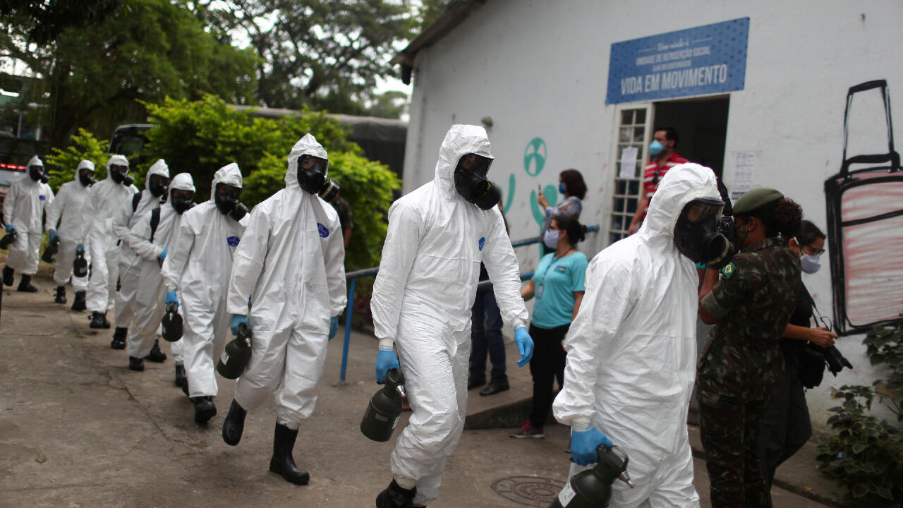 Brazilian army officers wearing protective gear arrive on May 14, 2020, to disinfect the shelter Stella Maris Complex for elderly people, homeless and patients with mental disorders managed by the Rio de Janeiro City Hall amid concerns of the spread of the Covid-19 in Brazil.