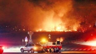 Fanned by strong winds the fire quickly spread through the mountainous area close to the border with North Korea, incinerating 400 homes and 500 hectares of land