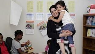 Enaam Husein et sa fille