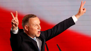 Polish President and presidential candidate of the Law and Justice (PiS) party Andrzej Duda gestures as he speaks after the announcement of the first exit poll results on the first round of presidential elections in Warsaw, Poland, on June 28, 2020.