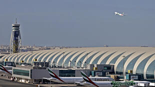 An airplane takes off from Dubai International Airport on Monday; Dubai-based Emirates Airline said it plans to make daily deliveries of coronavirus vaccines on its fleet