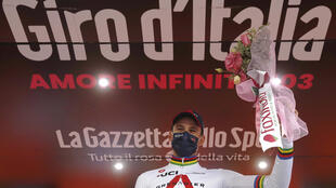 Italy's Filippo Ganna celebrates his stage 14 time trial win, his third on this Giro