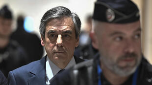 Former French Prime minister Francois Fillon returns to the courtroom at the Paris' courthouse, on February 27, 2020, for the hearing of his trial over claims he embezzled over €1 million euros in an alleged fake-jobs fraud.