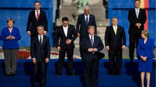 Donald Trump pose notamment avec Angela Merkel, Jens Stoltenberg et Theresa May lors du sommet de l'Otan à Bruxelles, le 11 juillet 2018.