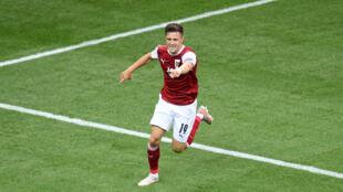 مهاجم النمسا كريستوف باومغارتنر يحتفل بتسجيله هدف الفوز في مرمى اوكرانيا (1-صفر) في الجولة الثالثة الاخيرة من دور المجموعات لكأس أوروبا في 21 حزيران/يونيو 2021.