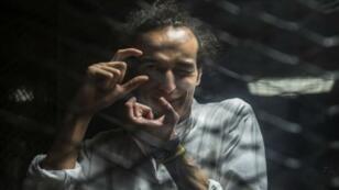 المصور الصحفي شوكان خلال محاكمته 9 أغسطس 2016