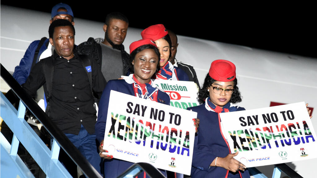 Image result for Nigerian returnees from South Africa arrive