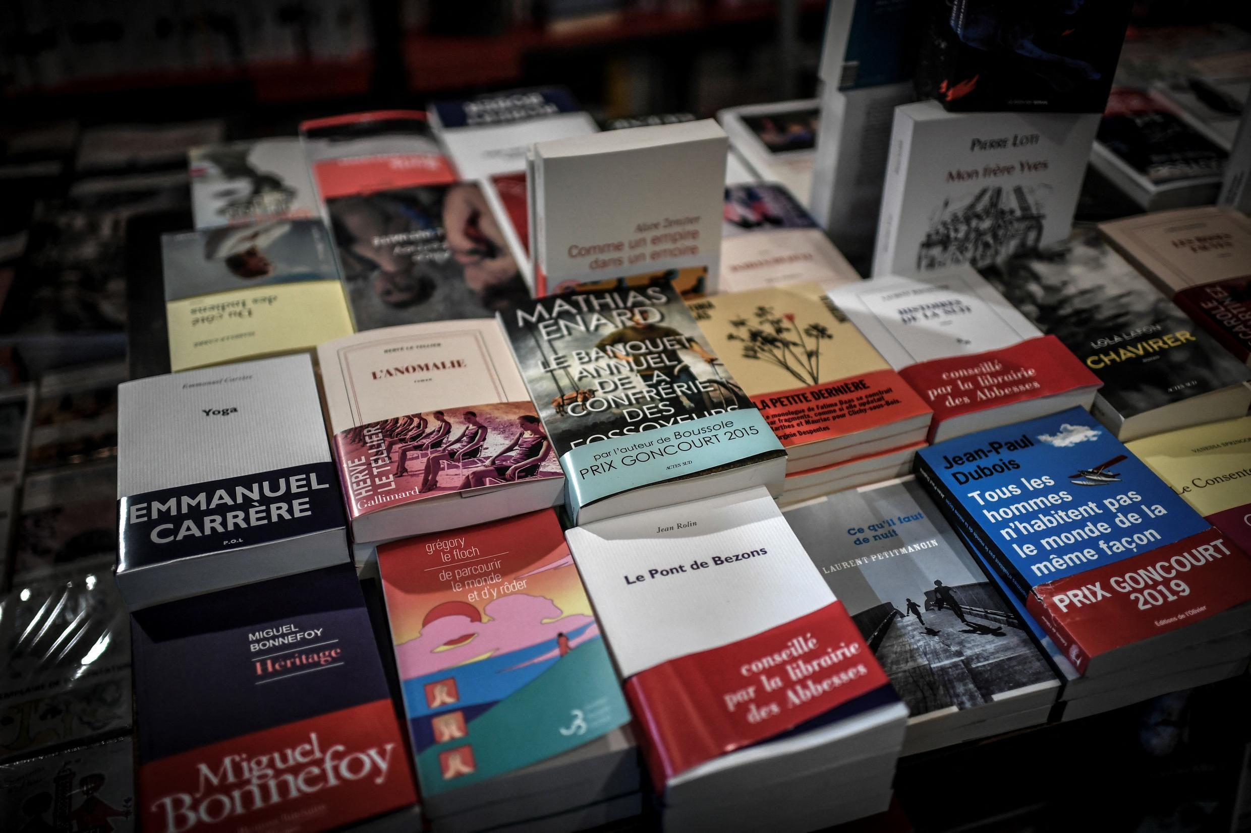 This photograph taken on November 2, 2020 shows books displayed at the Librairie des Abbesses bookstore in the Montmartre district in Paris on November 2, 2020.
