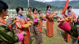 Bhutanese schoolgirls practice a dance. Teachers in the Himalayan kingdom will see a pay rise of 100 percent and allowances