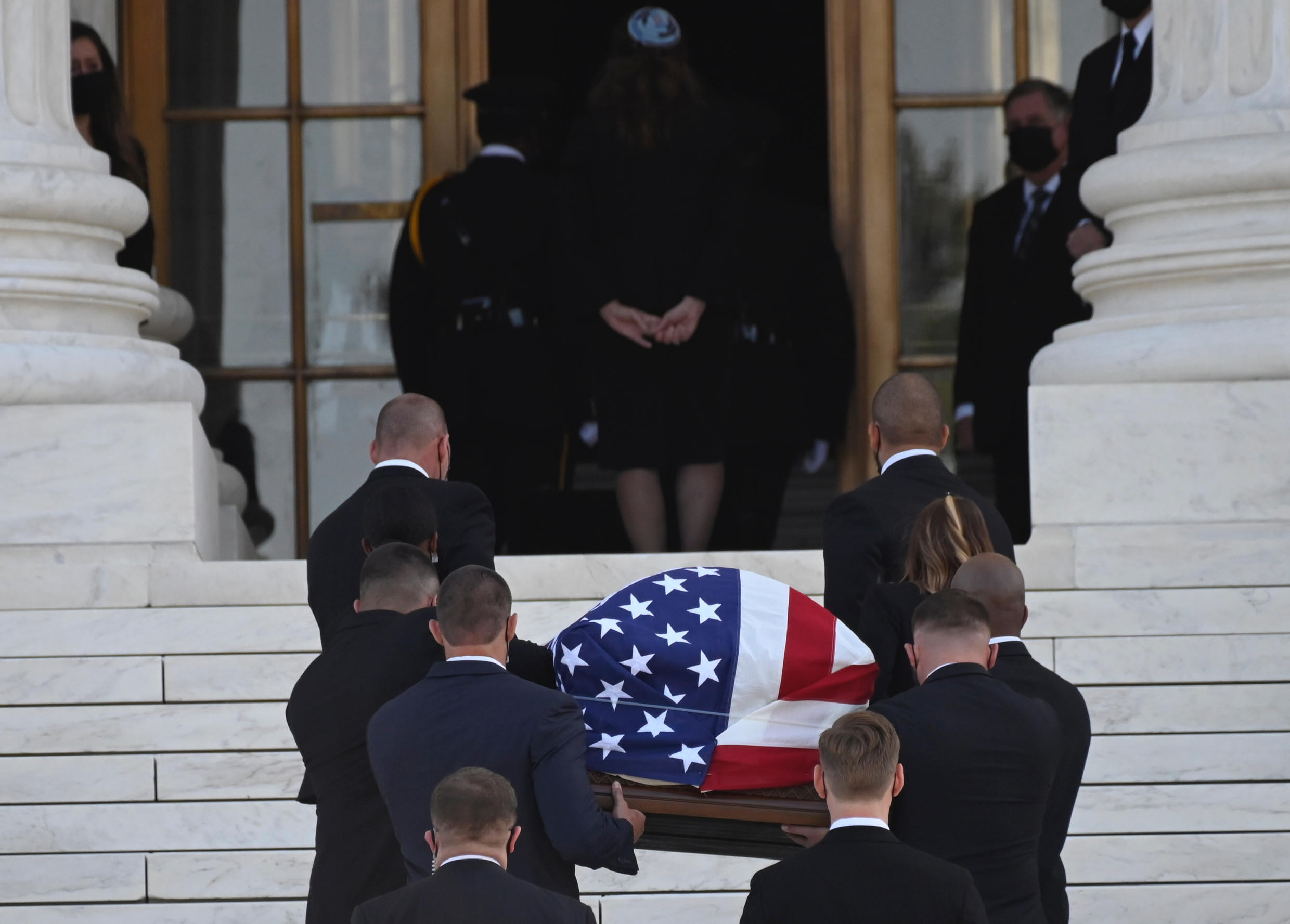 The flag-draped casket of the late US Supreme Court Justice Ruth Bader Ginsburg arrives at the US Supreme Court in Washington, DC