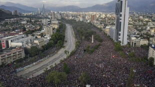 In this aerial view thousands of people protest in Santiago, on October 25, 2019, a week after protests started. Demonstrations against a hike in metro ticket prices in Chile's capital exploded into violence on October 18, unleashing widening protests over living costs and social inequality.