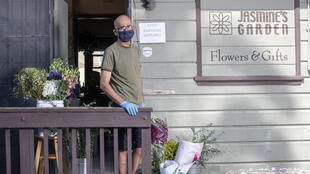 Jasmine's Garden flower shop owner Zohrab Mahdessian poses at his shop in the Los Angeles neighborhood of Los Feliz on May 7, 2020