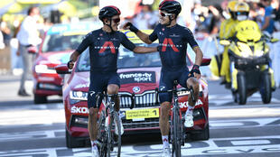 Team INEOS Grenadiers riders Richard Carapaz of Ecuador and Michal Kwiatkowski of Poland celebrate as they cross the finish line in La Roche-sur-Foron, France, on stage 18 of the Tour de France on September 17, 2020.