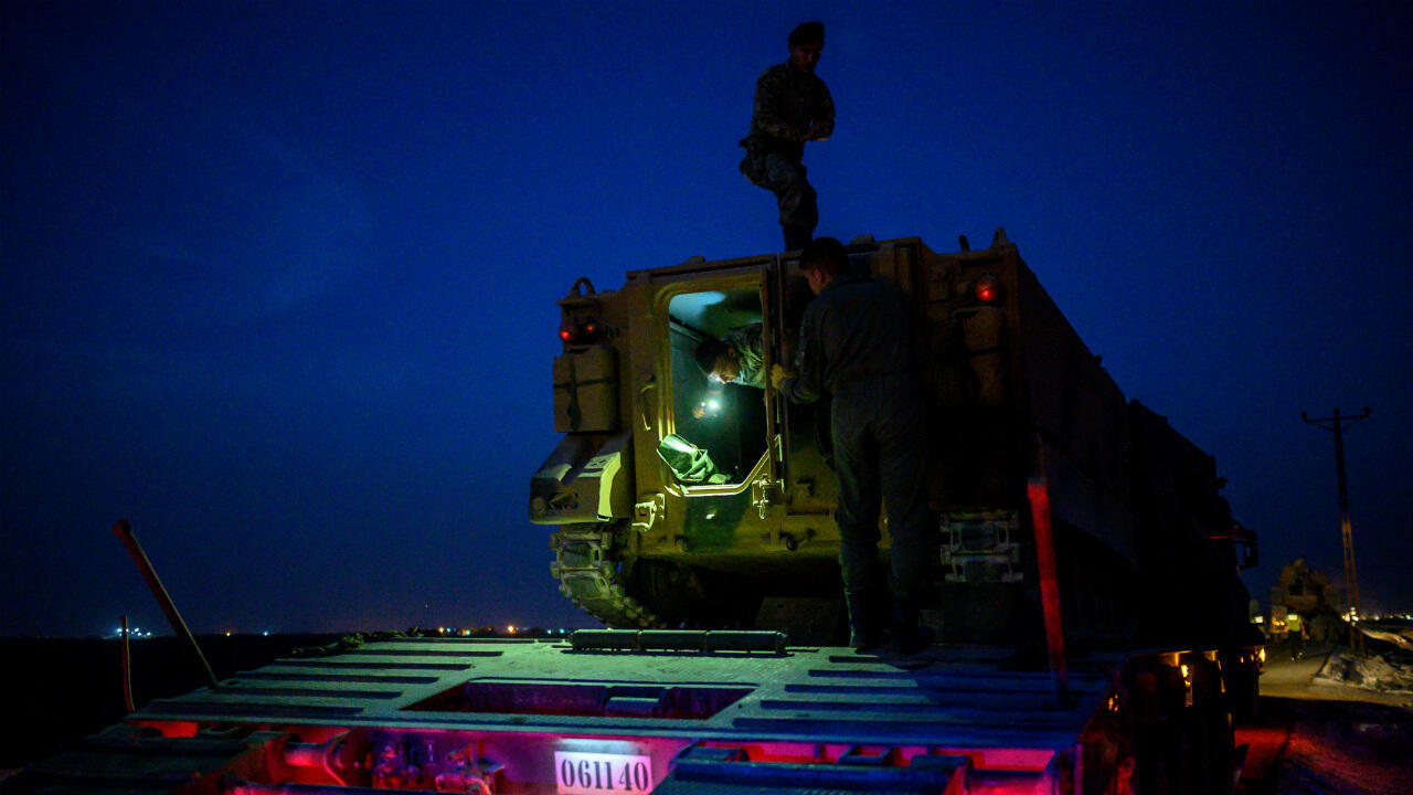 Turkish soldiers prepare an armored vehicle as Turkish forces drive towards the border with Syria near Akcakale in Sanliurfa province on October 8, 2019.