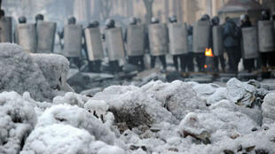 Riot police surround the Maidan protest camp in Kiev on January 27, 2014