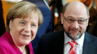 La canciller de Alemania, Angela Merkel y el líder del partido Socialdemócrata Martin Schulz.