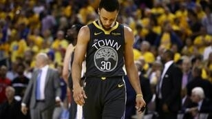 Golden State's Stephen Curry hangs his head late in a game-four loss to Toronto that put the Warriors on the brink of defeat in the NBA Finals