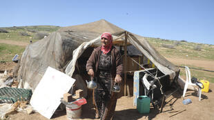 Fadwa Abdelghani walks outside her tent in the Bedouin village of Humsah al-Baqia, which has emerged as a flashpoint in the struggle over the Israeli-occupied West Bank