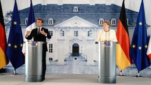المستشارة الألمانية أنغيلا ميركل والرئيس الفرنسي إيمانويل ماكرون