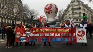 Protesters march against French President Emmanuel Macron's proposed pension reform in Paris on December 5, 2019.