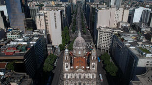 Aerial view of the Candelaria church and the empty Presidente Vargas avenue in downtown Rio de Janeiro, Brazil on March 25, 2020, during the outbreak of the new coronavirus