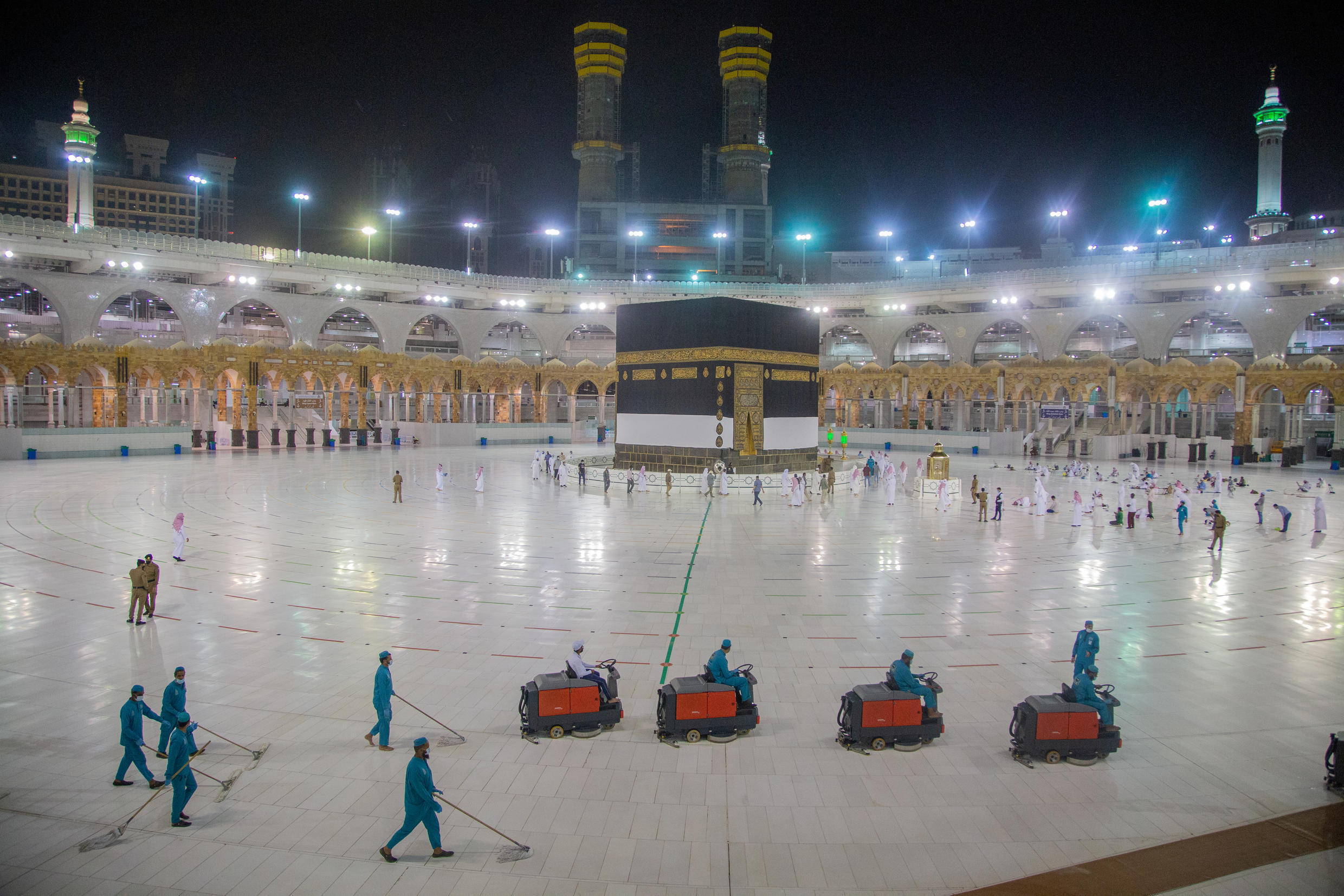 Workers clean around the area of the Kaaba at the Grand mosque on July 27, 2020.