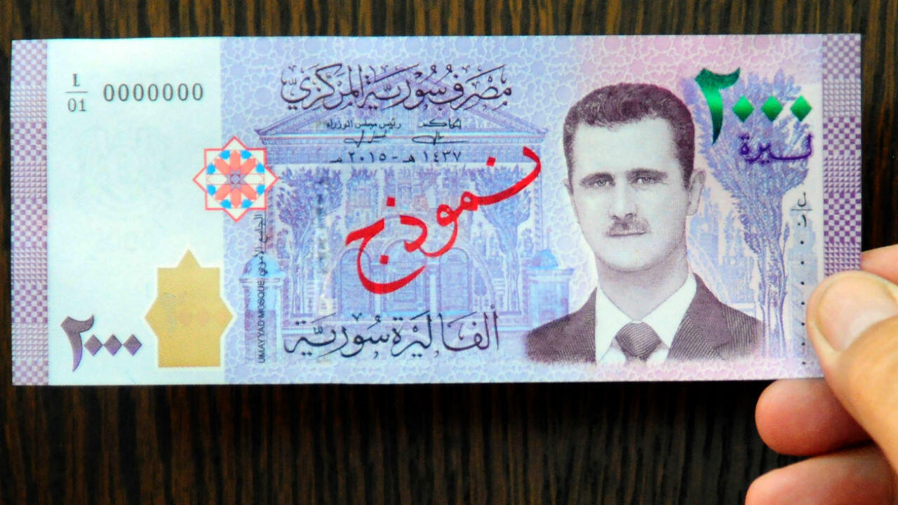 A handout picture released by the official Syrian Arab News Agency (SANA) on July 2, 2017, shows Syria's 2,000 pound note, featuring a portrait of President Bashar al-Assad.