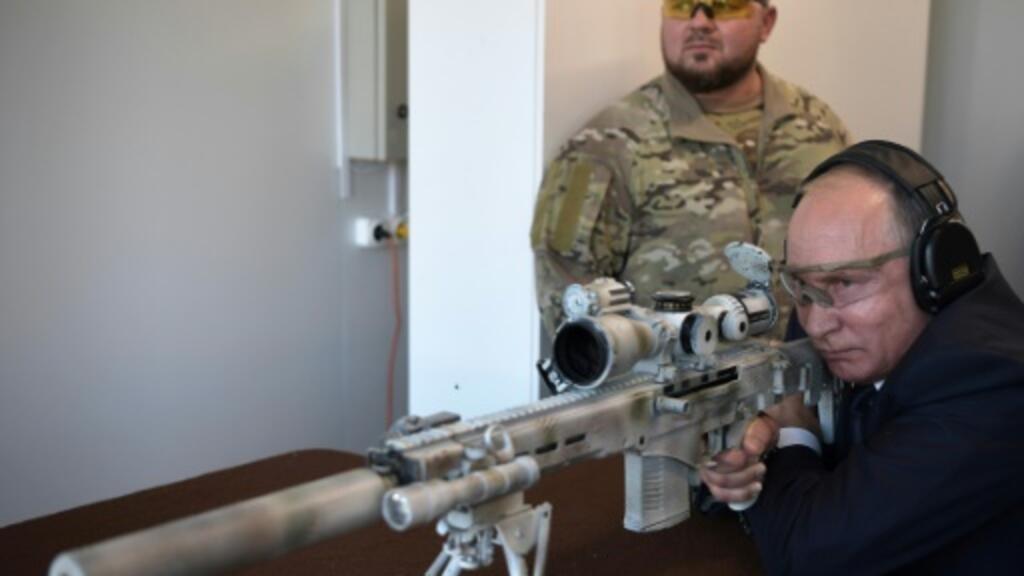 Putin shows off sniper skills firing Kalashnikov rifle