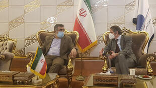 A handout picture provided by Iran's Atomic Energy Organisation on February 20, 2021, shows the Organization spokesman Behrouz Kamalvandi (L) speaking with the Director General of the International Atomic Energy Agency (IAEA), Rafael Mariano Grossi (R) upon his arrival at the Imam Khomeini International airport in Tehran.