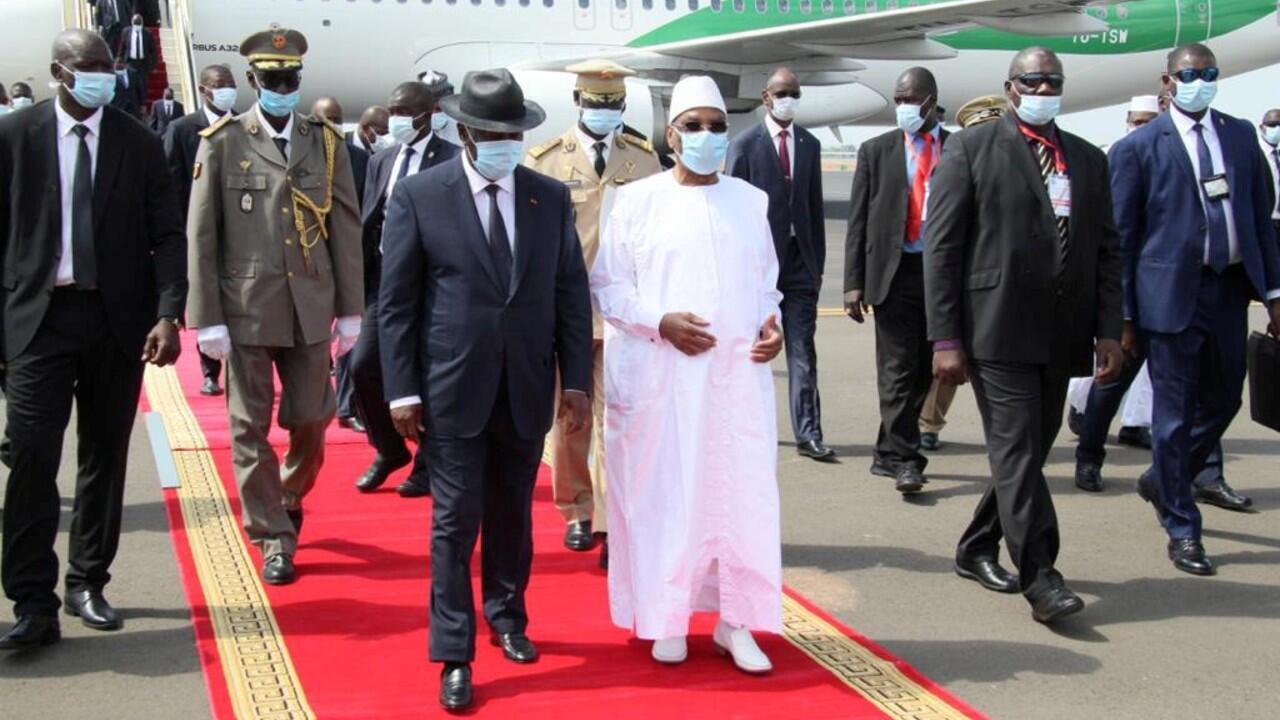 FILE PHOTO: Mali's President Ibrahim Boubacar Keita walks with his Ivory Coast counterpart Alassane Ouattara upon his arrival in Bamako, Mali July 23, 2020.