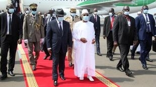 FILE PHOTO: Mali's President Ibrahim Boubacar Keita walks with his Ivory Coast counterpart Alassane Ouattara upon his arrival in Bamako, Mali July 23, 2020.