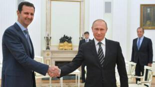 بشار الأسد وفلاديمير بوتين في موسكو في 20 تشرين الأول/أكتوبر 2015