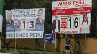 Political campaign posters in Lima, Peru, on January 25, 2020, a day before Peruvians head to the polls to choose a new Congress.