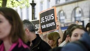 Opponents of a new French bill granting the state sweeping surveillance powers demonstrate in Paris on April 13, 2015