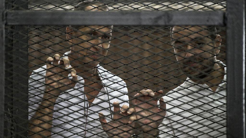 Le journaliste australien Peter Greste et l'Égyptien Mohamed Baher.