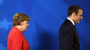 """France's President Emmanuel Macron's authority as a liberal champion has been dented by the """"yellow vest"""" protests, while the long reign of Germany's Chancellor Angela Merkel is coming to an end"""