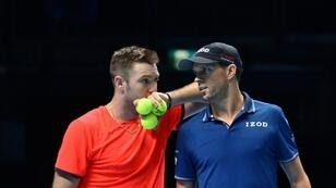 Jack Sock and Mike Bryan (right) beat Pierre-Hugues Herbert and Nicolas Mahut to win the ATP Finals doubles title