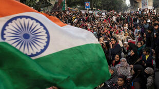 Demonstrators attend a protest against a new citizenship law, outside the Jamia Millia Islamia university in New Delhi, India, December 22, 2019.