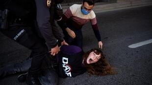 Turkish police detain a woman trying to protest in Istanbul on May 1 despite a Covid-related ban on demonstrations