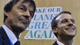 الرئيس ماكرون ووزير البيئة الفرنسي المستقيل نيكولا هولو.