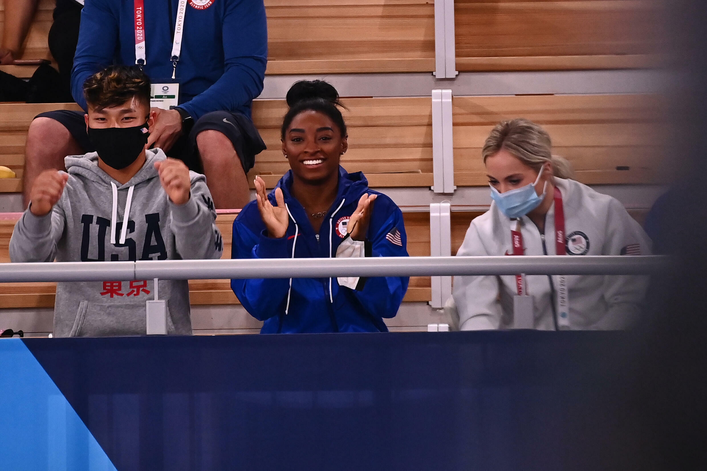USA's Simone Biles (C) has been cheering from the sidelines since pulling out during the team final
