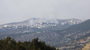 A picture taken from the Israeli side of the Blue Line that separates Israel and Lebanon shows smoke billowing above the Shebaa village sector in southern Lebanon after reports of clashes in the border area